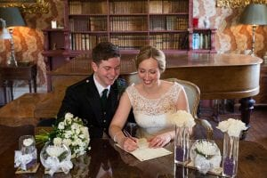 Couple signing a wedding contract