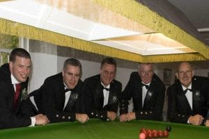 Three men behind a snooker table