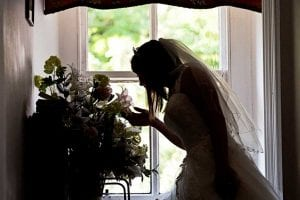 Bride smelling flowers